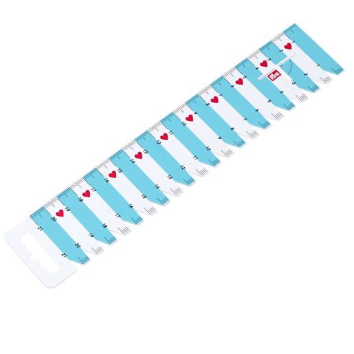 Riglă cu marcaje pentru cusut